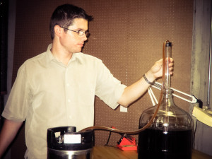 Racking (siphoning) the beer into the keg